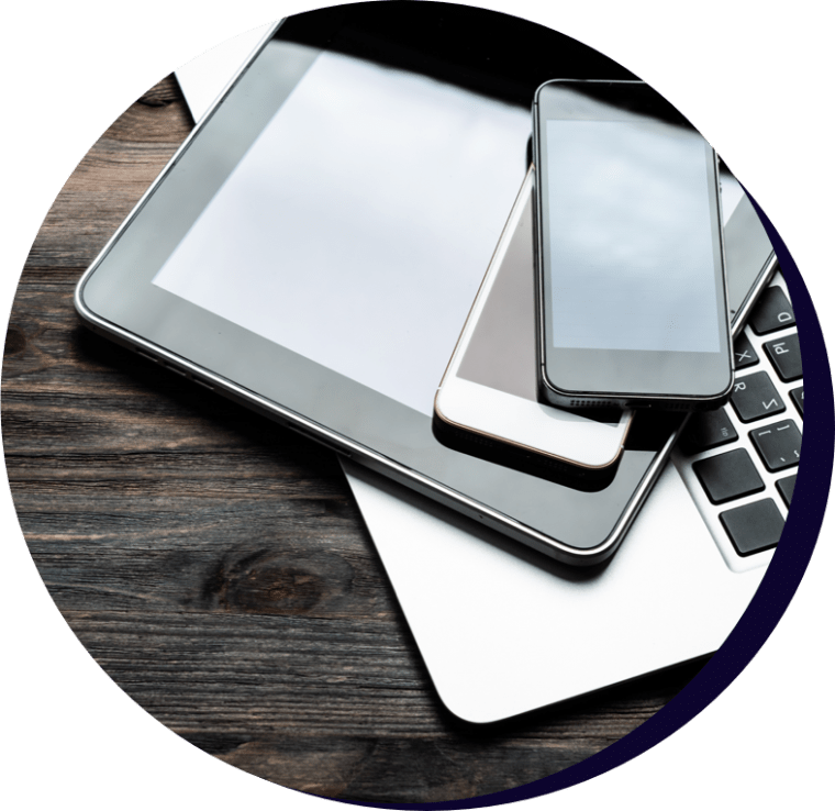 Laptop, tablet and mobile devices on top of one another