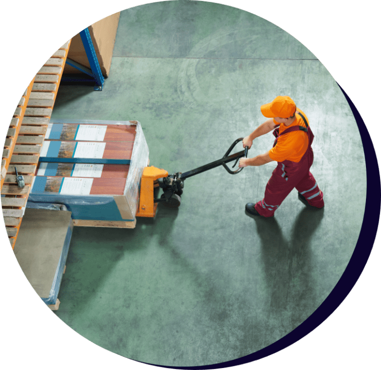 Factory worker moving a palette of goods